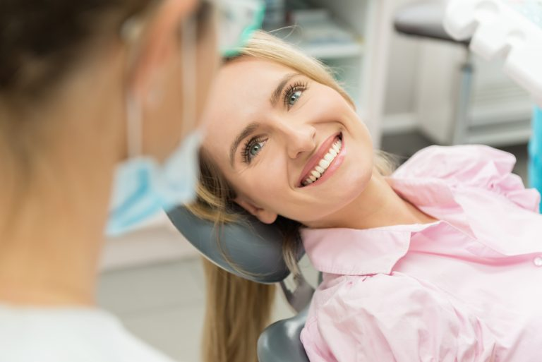 Beautiful Patient Smiling At Doctor