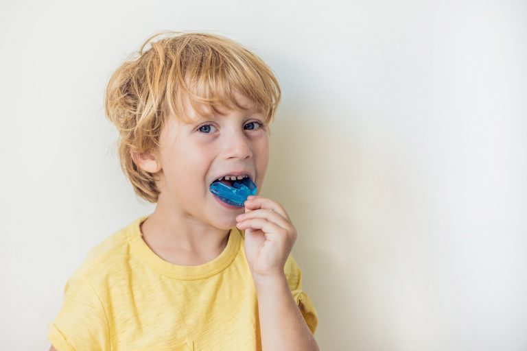 Three Year Old Boy Shows Myofunctional Trainer To Illuminate Mouth Breathing Habit. Helps Equalize The Growing Teeth And Correct Bite. Corrects The Position Of The Tongue